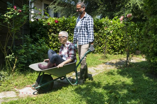 Mature couple enjoy working at their garden